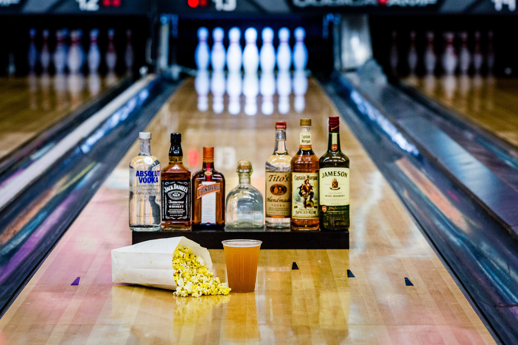 liquor bottles on bowling lanes